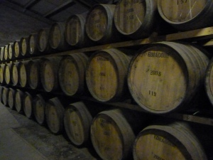 Whisky casks resting and maturing in the warehouse.