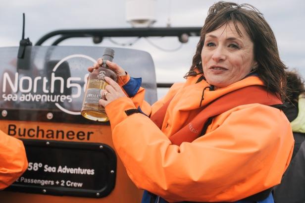 Glenglassaugh - Rachel Barrie with Glenglassaugh Evolution during boat tour along Portsoy coast